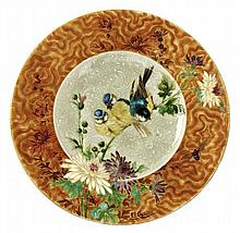 ATELIER THÉODORE DECK & Ernest CARRIERE (1858-1908)-(peintre) A circular enamelled earthenware plate, decoration designed and made by E