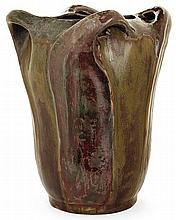 GLATIGNY A flared enamelled porcelain vase with vegetable decoration, circa 1899. Incised signature. Height. 8 3/4 In.