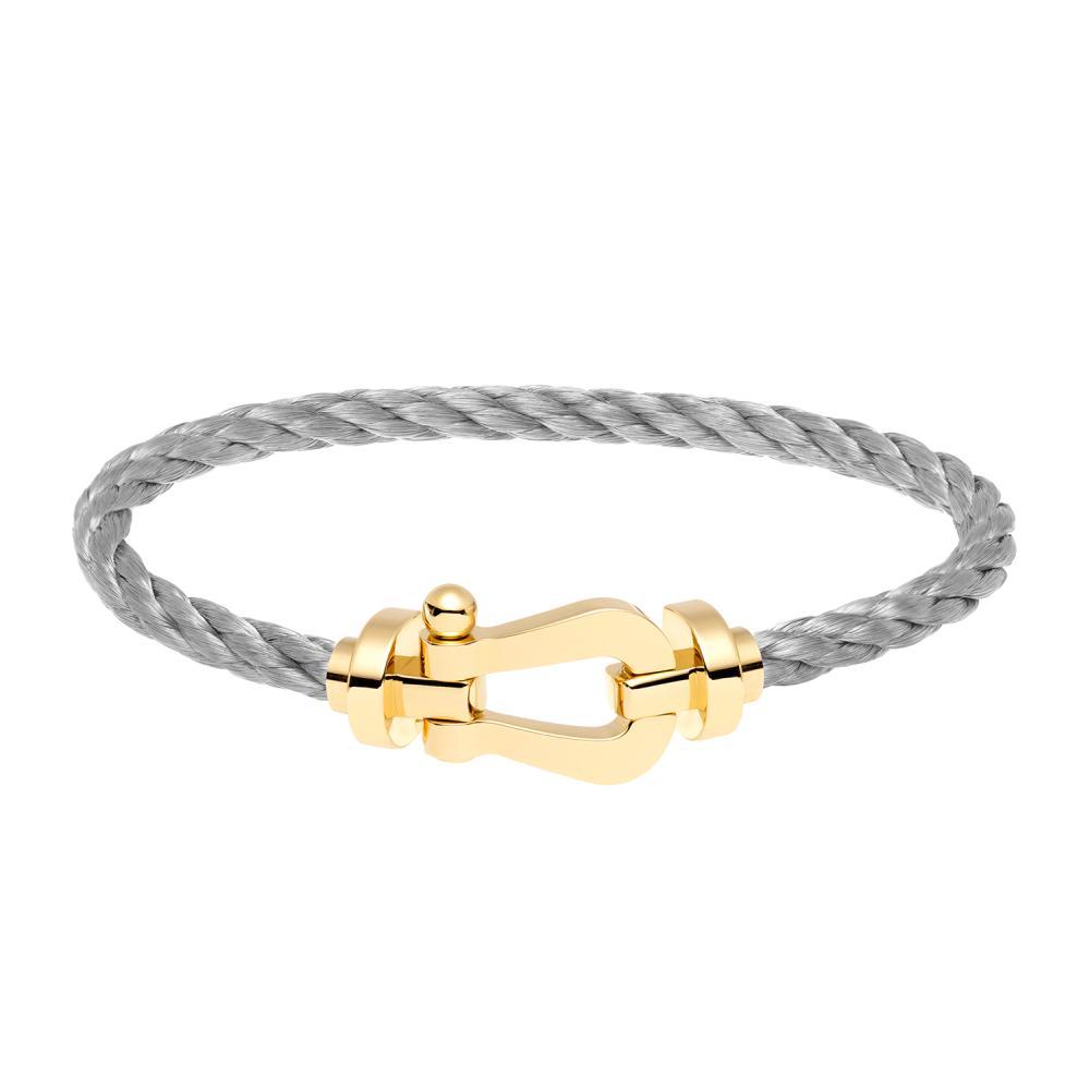 Fred bracelet Force 10, grand modèle en or jaune, câble en acier. Emblème de la Maison, le bracelet Force 10, créé en 1966, porte...