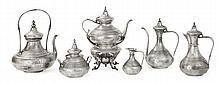 DUPONCHEL Service thé-café en argent, modèle de style oriental, de forme balustre à fond plat, gravé de motifs orientaux sur fond am...