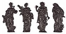 SUITE DE QUATRE FIGURES D'APPLIQUE  en bronze fondu et ciselé à patine noire figurant les quatre saisons
