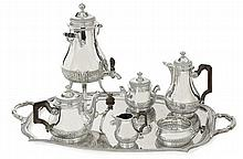 A silver and silver plated six-piece tea and coffee service with coat of arms. LONG. DU PLATEAU 75 cm - LARG. 47,3 cm POIDS BRUT DES PI