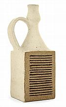 BRUNO GAMBONE (né en 1936) A quadrangular enamelled stoneware bottle vase with a side handle. Geometrical decoration, circa 1975-80. En