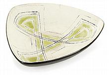DENISE GATARD (1908-1992) A triangular enamelled earthenware plate with a geometrical pattern. Incised signature. Height. 2 3/4 IN. - L