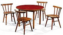 ANNÉES 1950 A wood and plywood set of a table and four chairs, red linoleum table top. TABLE : Height. 21 5-8 in. - diam. 31 3-4 in. -