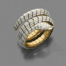 TIFFANY & C° RARE BRACELET SERPENT An enamel, diamond and gold bangle by TIFFANY & C°.