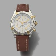 BREITLING CHRONOMAT. RÉF. B13050 VENDUE EN 2000 A gold and stainless steel self winding chronograph by Breitling.