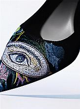 CHRISTIAN DIOR A pair of leather pumps with multicolored embroidery, based on a theme from the fall/winter 2013/2014 collection...