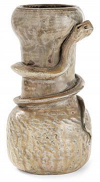 Théo PERROT (1856-1942) Vase balustre en grès à corps guilloché et corps bulbaire, animé d'un serpent en relief en enroulement. Déco...