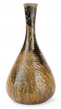 Théo PERROT (1856-1942) Vase tronconique élancé en grès à décor de frises guillochées et de cannelures, col légèrement évasé. Décor ...