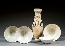 Three celadon and qingbai bowls, China, Song dynasty & Korea, 14th-15th century. H.(max) 2 3/8 in. - D. (max) 7 1/16 in.