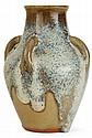 Auguste DELAHERCHE (1857-1940) Vase balustre en grès, épaulement galbé muni de quatre prises détachées, col ourlé d'un jonc. Décor d...