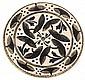 André METHEY (1871-1920) Plat circulaire en faïence sur talon, décor végétal stylisé émaillé bleu et noir, rehauts d'or craquelé, fo...