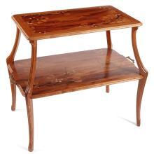 LOUIS MAJORELLE (1859-1926)Table à thé à deux plateaux en noyer, piétement végétal sculpté, plateaux rectangulaires, à décor marquet...