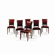 MAXIME OLD (1910-1991) A set of six neoclassical walnut chairs, red imitation leather upholstery. H 34 1/2 x W 18 1/2 x D 18 1/4...