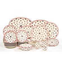 MARCEL GOUPY (1886-1954)Service de table en faïence à décor floral comprenant : 3 plats ovales 6 petits plats ovales 2 pièces de ...