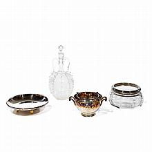 Ensemble d'argenterie et cristallerie Lot of four items including: a cup with ivory base, a cup of baccarat crystal, a caviar bowl w...
