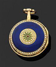 Mel MAGNENT à PARIS SECONDE MOITIÉ XVIIIème siècle Montre de poche à toc en or jaune époque Louis XV. Lunettes décorées de feuillage...