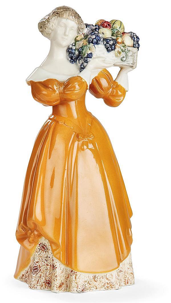 EMIL MEIER (1877-1952) & GOLDSCHEIDER WIENER Sculpture en faïence représentant une jeune femme costumée portant une corbeille de fru...
