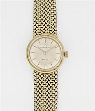 ETERNA MATIC SAHIDA ANNEES 50 Montre bracelet de dame en or jaune avec boîtier rond. Cadran argenté avec index bâtons gravés. Mouvem...
