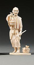 An ivory okimono, signed. Japan, Meiji period. H. 11,8 cm (4 5/8 in.)