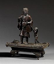A bronze okimono. Japan, Meiji period. H. (total) 33 cm (12.9 in.)