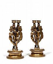 Arman (1928-2005) Paire de bougeoirs angelot, 1991 Bronzes à patine dorée Signés et numérotés EA 9/20 et EA 10/20 D'une édition à 40 exemplaires + 20 EA Fondeur Bocquel  Haut. : 22,5 cm