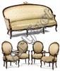 MOBILIER DE SALON comprenant un canapé corbeille, quatre fauteuils et deux chaises à dossier médaillon, de forme mouvementée en palissa