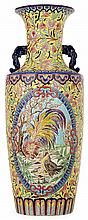 R. RIZZI (décorateur) - LONGWY (manufacture) An important baluster faience vase with multicolored enamels and two handles. Producter's