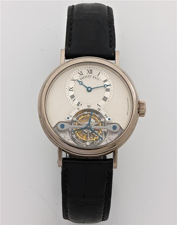 BREGUET TOURBILLON. RÉF. 3357. Montre bracelet en or gris. Cadran ivoire guilloché main avec cadran décentré et cage du tourbillon a...