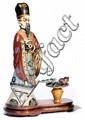 STATUE en bronze et émaux cloisonnés polychromes, la tête et les mains en ivoire sculpté, peint et patiné, représentant un divinité mas