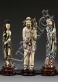 LOT DE TROIS STATUETTES en ivoire sculpté et gravé, deux personnages en pied polychromes, la femme tenant une branche de rosier, l'homm