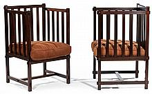 ANNÉES 20 A pair of large cubic mahogany armchairs, seat cushions. Height. 35 3/8 in. - Width. 21 1/4 in. Depth. 22 1/2 in.