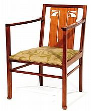 ARTS & CRAFTS A large mahogany armchair, openwork backrest, non original fabric. Height. 32 3/4 in. - Width. 23 1/4 in. - Depth. 23 3/8