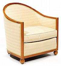 Jules Leleu (1883-1961) A walnut armchair with spherical legs, circa 1929. Height. 29 1/2 in. - Width. 25 5/8 in. - Depth. 27 1/2 in.