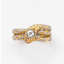 Bague serpent en or jaune et platine gravés, la tête porte un diamant taille brillant (TA). Travail des années 1890. Poids brut : 5,...