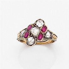 Bague  en or jaune ornée d'une ligne diagonale sertie de diamants taillés en rose entre deux lignes de rubis