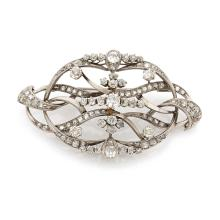 A diamond and gold brooch, circa 1920.