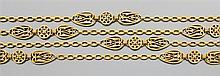 Sautoir en or jaune à maillons forcats. Il est orné de grands motifs ronds et piriformes ajourés. Travail français des années 1860. ...