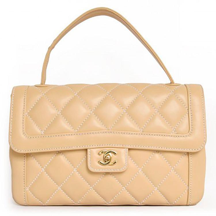 CHANEL Sac à main Chanel Timeless en cuir matelassé beige