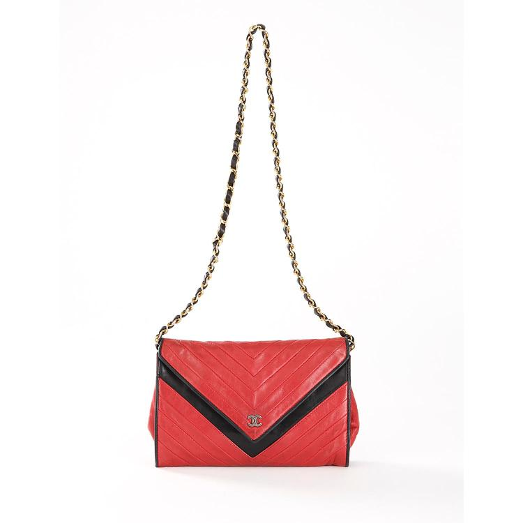 CHANEL Sac pochette Chanel vintage en cuir bicolore