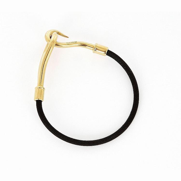 HERMÈS Bracelet Hermès Jumbo en métal doré et lien tissu noir
