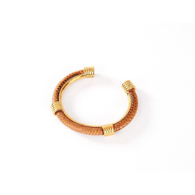 #HERMÈS Bracelet jonc Hermès en lézard et plaqué or