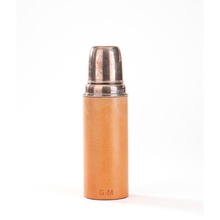 HERMÈS Thermos Hermès en métal argenté, gainé de cuir de Pecari gold