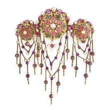A ruby, natural pearl, enamel and gold stomacher, circa 1850.