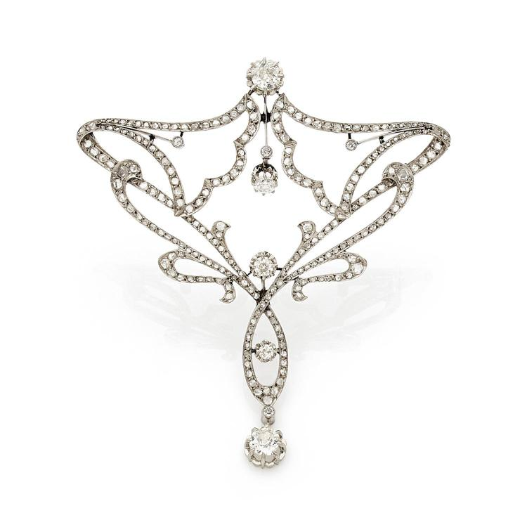 An Art Nouveau diamond and platinum brooch, with chain.