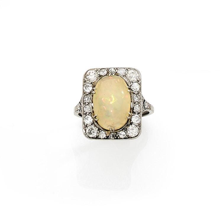 An opal, diamond and gold ring, circa 1900.