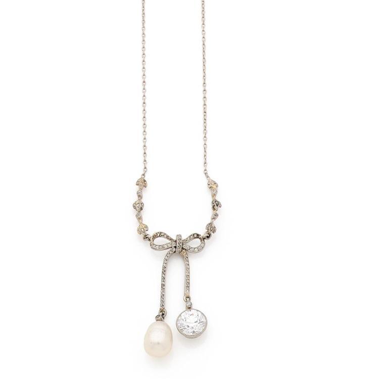 A diamond, natural pearl, platinum pendant.