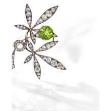 RENE LALIQUE ANNEES 1892-1894 A peridot, diamond, gold and silver brooch by RenE LALIQUE, circa 1892 - 1894.