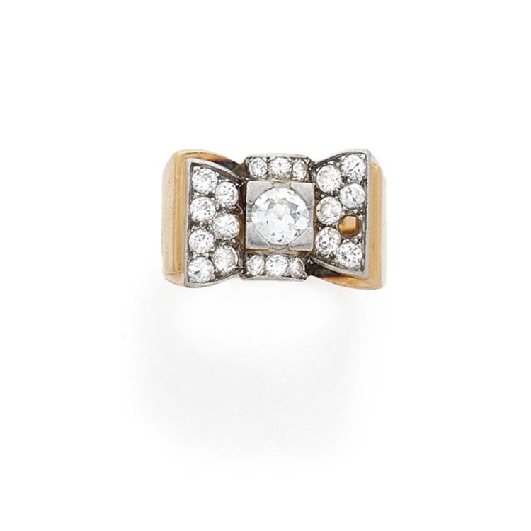 A diamond, gold and platinum ring, circa 1935.